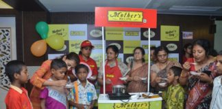 Mothers And Children Of Baruipur Sitakundu Sneh Kunja (BSSK) Making Payesam Together And Feeding Each Other.