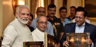 """The Prime Minister, Shri Narendra Modi releasing the photo book titled """"President Pranab Mukherjee - A Statesman"""" and presenting first copy to the President, Shri Pranab Mukherjee, at Rashtrapati Bhawan, in New Delhi on July 02, 2017."""