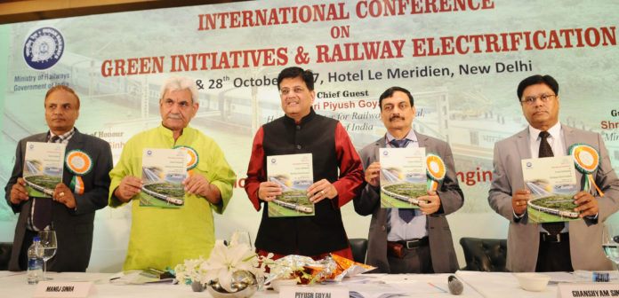 The Union Minister for Railways and Coal, Shri Piyush Goyal releasing the souvenir, at the inauguration of the International Conference on Green Initiatives & Railway Electrification, organised by the Ministry of Railways through Institution of Railways Electrical Engineer (IREE), in New Delhi on October 27, 2017. The Minister of State for Communications (I/C) and Railways, Shri Manoj Sinha, the Member Traction Railway Board & Patron, IREE, Shri Ghanshyam Singh and other dignitaries are also seen.