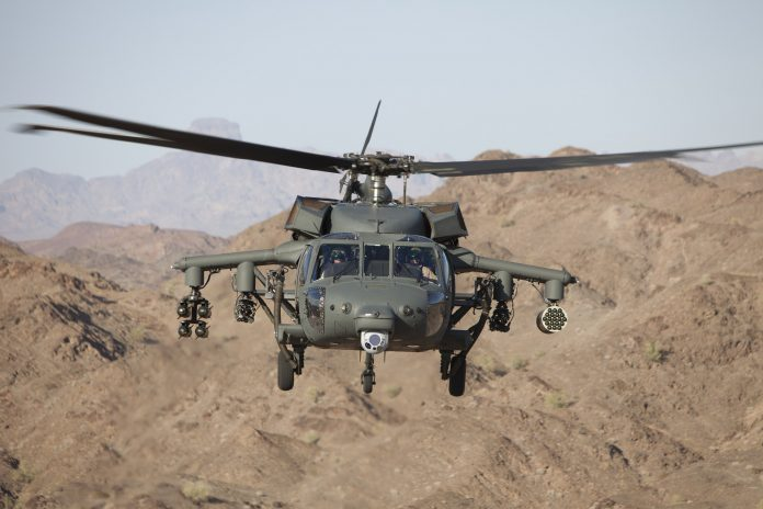 S-70 Black Hawk helicopter armed with four forward-firing guns, rocket pod and laser-guided missiles (PRNewsfoto/Lockheed Martin)