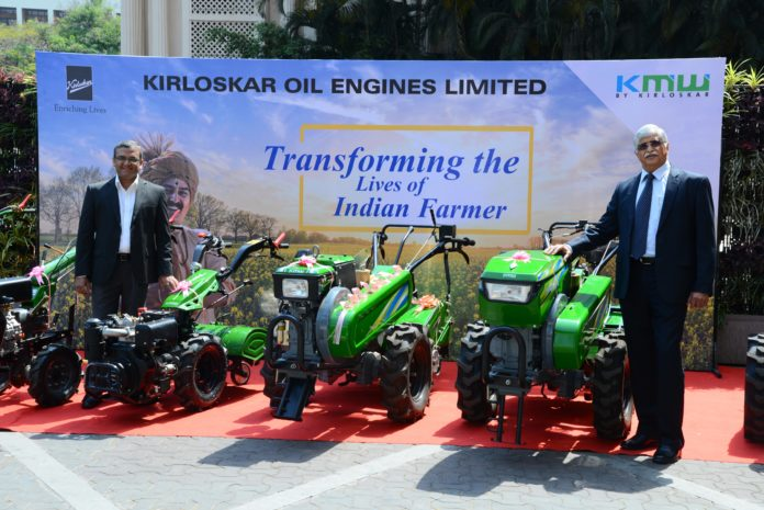 Mr. Antony Cherukara and MR R.R Deshpande displaying KMW's range of farm mechanization products that has made the company the most preferred brand amongst the farmers of India