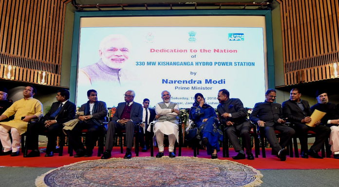 The Prime Minister, Shri Narendra Modi dedicates the 330 MW Kishanganga Hydropower Station to the Nation, at the Sher-i-Kashmir International Conference Centre (SKICC), in Srinagar on May 19, 2018. The Governor of Jammu and Kashmir, Shri N.N. Vohra, Union Minister for Road Transport & Highways, Shipping and Water Resources, River Development & Ganga Rejuvenation, Shri Nitin Gadkari, Minister of State for Development of North Eastern Region (I/C), Prime Minister's Office, Personnel, Public Grievances & Pensions, Atomic Energy and Space, Dr. Jitendra Singh, the Chief Minister of Jammu and Kashmir, Ms. Mehbooba Mufti and other dignitaries are also seen.