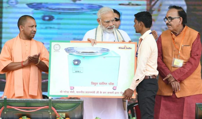 The Prime Minister, Shri Narendra Modi at the inauguration of the various development projects, in Varanasi, Uttar Pradesh on September 18, 2018. The Chief Minister of Uttar Pradesh, Yogi Adityanath is also seen.
