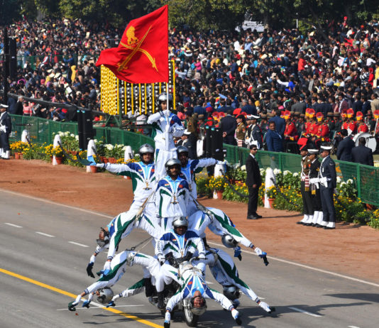 Rajpath comes alive with the dare devil stunts of motorbike riders of Corps of Military Police, at the 70th Republic Day Celebrations, in New Delhi on January 26, 2019.