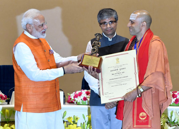 The Prime Minister, Shri Narendra Modi presenting Yoga awards to the winners of the Prime Minister's Award for Outstanding Contribution for Promotion and Development of Yoga, at a function, in New Delhi on August 30, 2019. The Secretary, Ministry of AYUSH, Shri Vaidya Rajesh Kotecha is also seen.