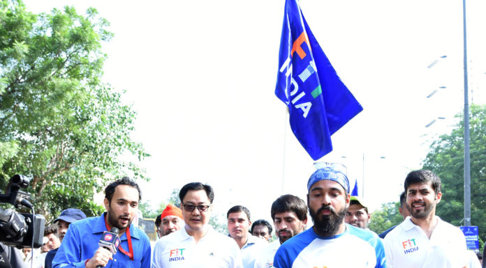 The Minister of State for Youth Affairs & Sports (Independent Charge) and Minority Affairs, Shri Kiren Rijiju at the flag off ceremony of the Fit India Plog Run, on the occasion of the 150th Birth Anniversary of Mahatma Gandhi, in New Delhi on October 02, 2019. The Eminent Athletes and Indian Plogger, Ripu Daman is also seen.