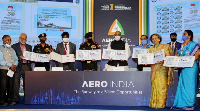 The Union Minister for Defence, Shri Rajnath Singh releasing the DRDO Documents & Procedures 2021, during the Aero India 2021, at Yelahanka, in Bengaluru on February 03, 2021. The Chief of Defence Staff (CDS), General Bipin Rawat, the Chief of the Air Staff, Air Chief Marshal R.K.S. Bhadauria, the Chief of the Army Staff, General Manoj Mukund Naravane and the Secretary, Department of Defence R&D and Chairman, DRDO, Dr. G. Satheesh Reddy are also seen.