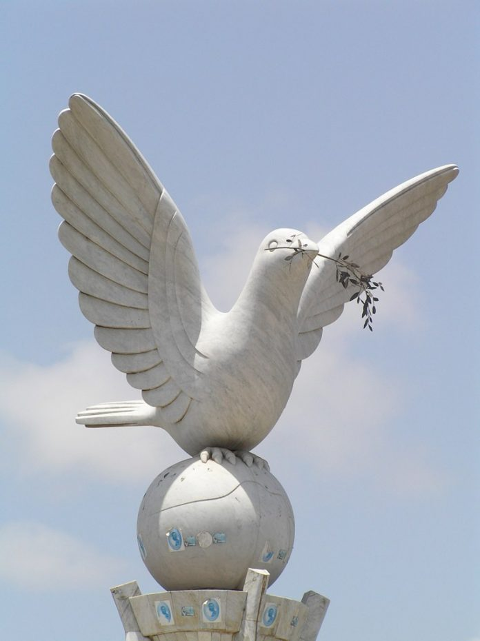 Peace dove statue in Lomé, Togo, Africa. The dove and the olive branch are the most common symbols associated with peace. by Wikipedia