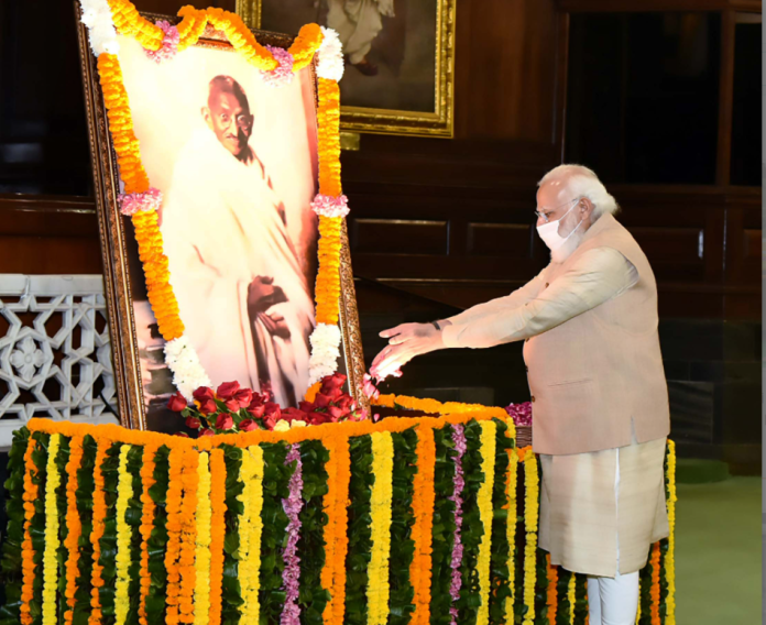 The Prime Minister, Shri Narendra Modi paying tributes to Mahatma Gandhi on his 152nd birth anniversary, at Parliament House, in New Delhi on October 02, 2021